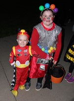 A boy and girl in Halloween costumes