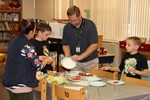 students and staff prepare to sample recipes
