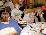 Student serves meal to senior citizens