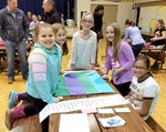 Group of girls at activity center during Mathapalooza event