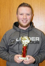 Photo of Ivan Gates with first place trophy from SkillsUSA regional competition