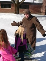 Photo of Brookside Principal Erin Eckert dressed as groundhog greeting students