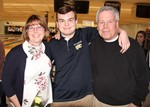 PHOTO of senior athlete with his parents