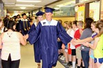 Graduating senior greeted by elementary students