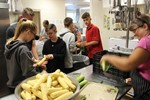 Students shucking corn