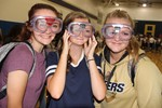 Three girls try out special goggles