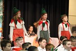 Girls dressed as elves dance