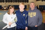 Photo of student athlete and parents