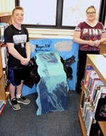 Boy and girl stand with their Niagara Falls project