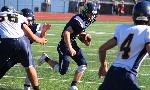 quarterback logan haskell runs with football