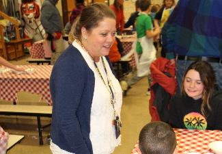 Mrs. Hatton greets kids at pasta fiesta