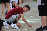 students use chalk on sidewalk