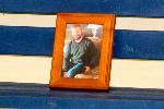 Photo of Lee Norris on memorial bench