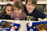 three children eating lunch