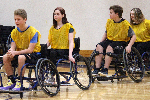 students play wheelchair basketball