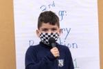 boy recites poem
