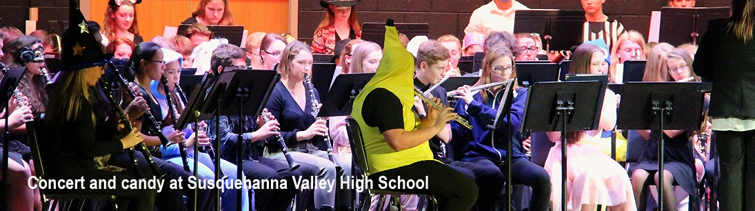 high school musicians in concert, some in halloween costumes