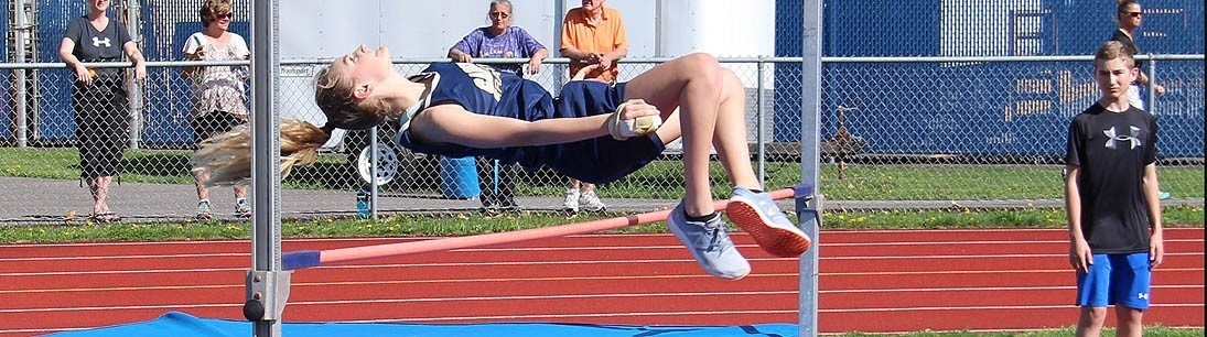 Girl high jumper going over the high jump bar