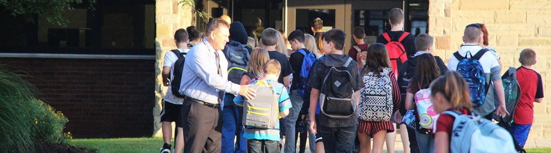 Superintendent greets students heading into middle school