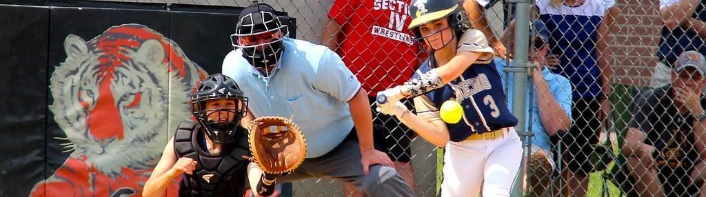 Female softball hitter swings at ball