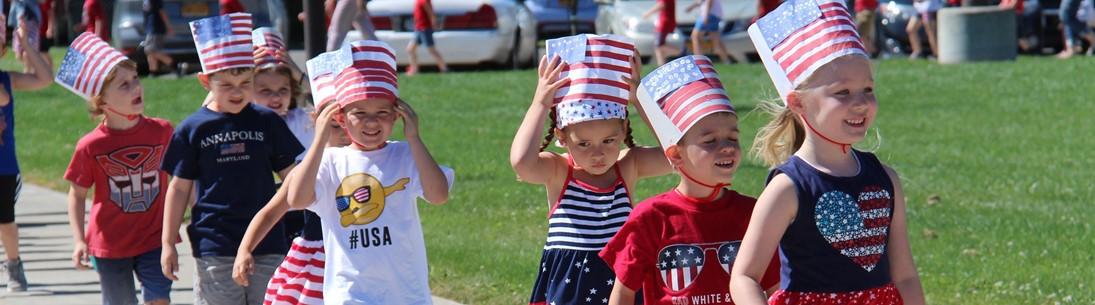 Children march in flag day celebration