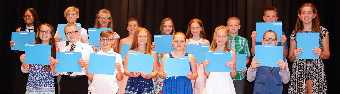 Students hold up blue folders containing awards
