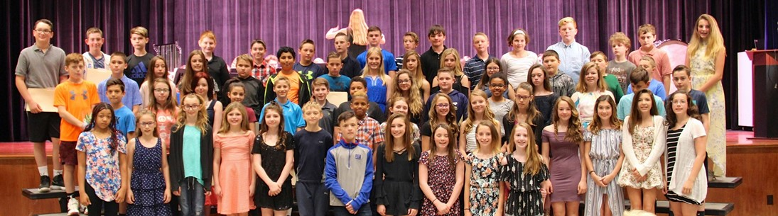 group of middle school students at awards ceremony
