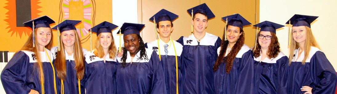 graduates pose for group picture