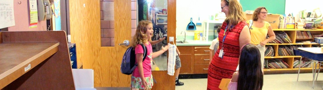 young girl happy to enter class