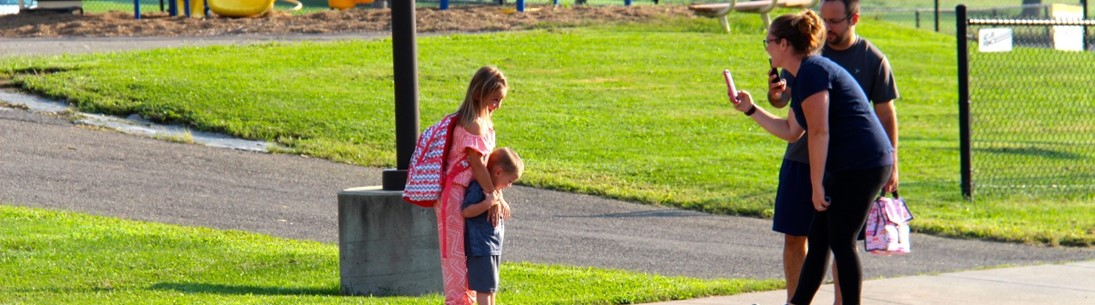 parents take pics of children on first day of school