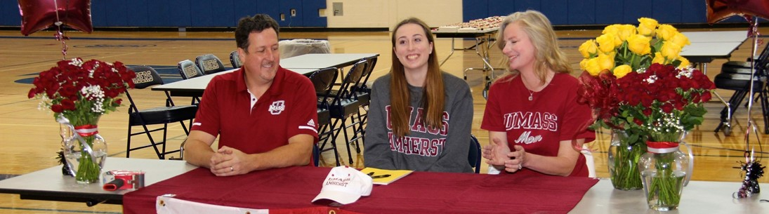 maeve and parents at signing table