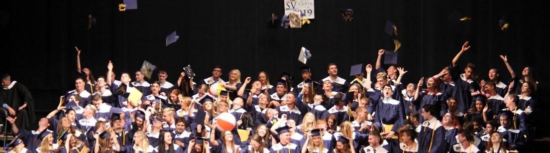 Class of 2019 graduates toss caps