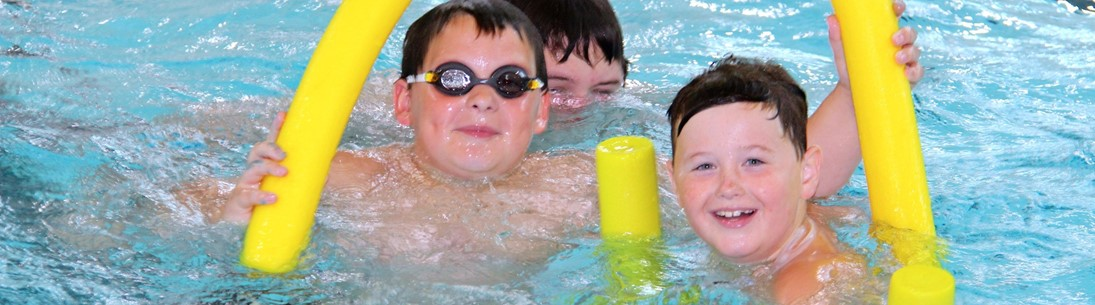 three boys swimming