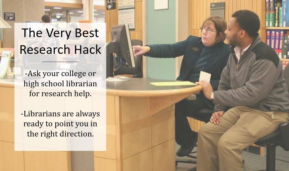 College librarian helping student