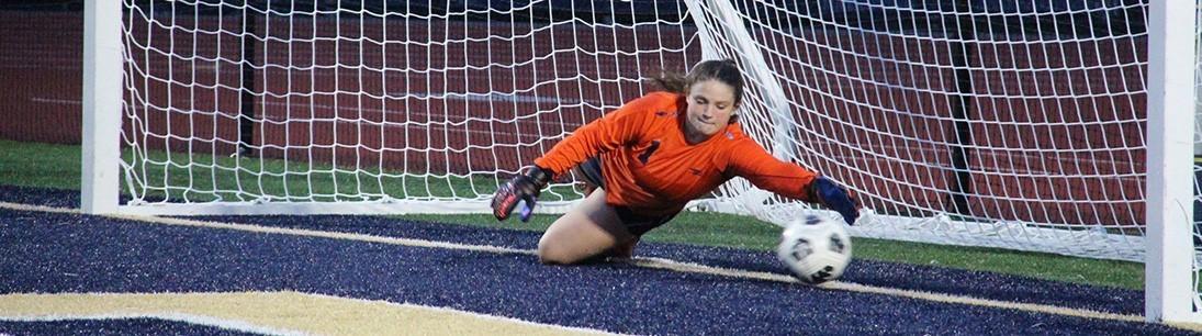 girls soccer goalie making save