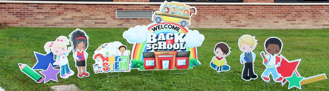 Cardboard lawn display reading Welcome Back to School