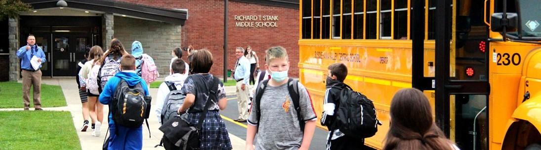 Students walk toward Richard T. Stank Middle School