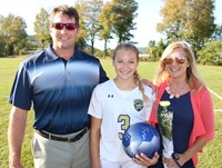 Photo of female soccer player and her parents
