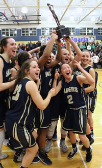 Sabers girls basketball players celebrate with STAC trophy