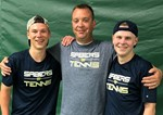 Photo of doubles champs with coach